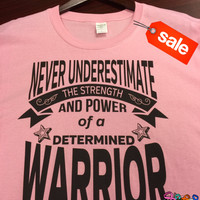 On Sale: Never Underestimate The Strength and Power of a Determined Warrior Light Pink Shirt (FREE SHIPPING in U.S)