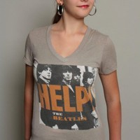 The Beatles Help Tee from Trunk Ltd. is a must for your t-shirt collection. Help Beatles Tee