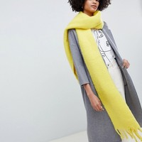 ASOS DESIGN bright fluffy tassel scarf at asos.com