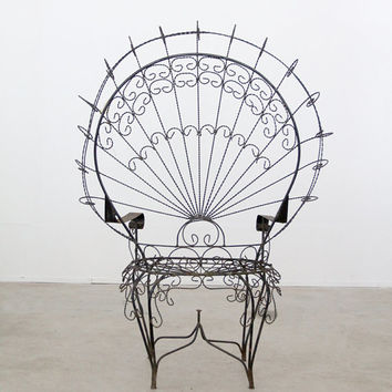 antique wrought iron chair / peacock chair