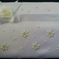 wedding guest book covered with satin and tole fabrics staffed with sponge and topped with pearls and crystals.