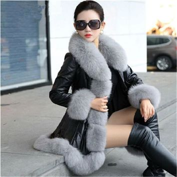 56=8XL 2018 Winter New Fashion PU Stitching Faux Fur Coats Women Fake Fox Collar Long Leather Jacket Slim Plus Size Parka A1474