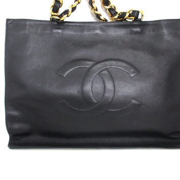Vintage CHANEL black calfskin large tote bag with gold tone chain handles and CC motif. Classic purse for school, work, shopping, daily use