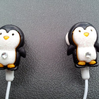 So cute little Penguin earbuds with glitter and a swarovski crystal