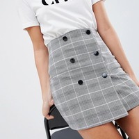 ASOS DESIGN double breasted mini skirt in check at asos.com