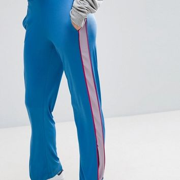 ASOS Track Pants with Contrast Stripe and Zip Hem at asos.com