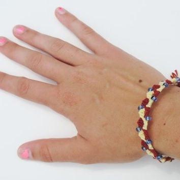 Handmade Friendship Bracelet - Light Yellow and Maroon Donut Hole Pattern with Small Blue Beads