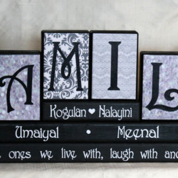Our Family personalised with family member names on wood blocks