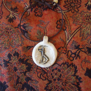 The expelled letter. Handmade ceramic pendant. White clay engraved with a Cyrillic letter no longer used. FREE SHIPPING