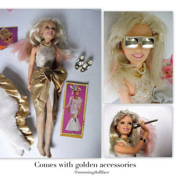 Glitter and Gold Jem Doll of the Jem Collection. 1987. Sparkle hair, microphone, shoes, bracelets, sunglasses, outfit.  Hasbro co.