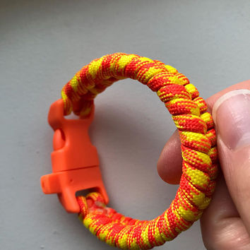 Bright Orange and Yellow Fishtail Paracord Bracelet with Survival Whistle Clasp Closure