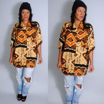Vintage 1990s  graphic Navajo inspired Oversize oversized9 SouthwesternTribal short sleeve Button Down shirt blouse