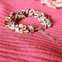 Colorful hippie bracelet. Pink beaded multistrand bracelet. Pink, red, black, yellow. Seed bead jewelry. Boho hippie bracelet. Adjustable.