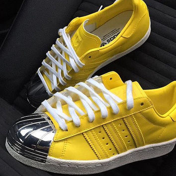 Customised 'Lemon Zest' Adidas Superstar 80s metal toe custom.