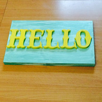 White washed seafoam and yellow Hello sign