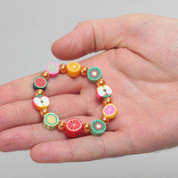 Beautiful bright handmade children's wrist bracelet with polymer clay fruit