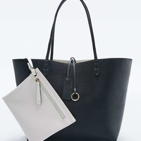 New Reversible Vegan Leather Tote Bag in Black and Ivory - Urban Outfitters