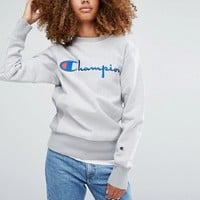 Champion Oversized Sweatshirt With Script Logo at asos.com