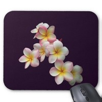 Plumeria blossoms on dark purple mouse pad
