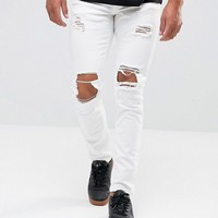 Mennace Muscle Fit Skinny Jean With Rips In White at asos.com