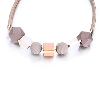 Neutral Bauble Statement Necklace in Textured Geo Shapes