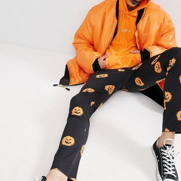 ASOS Halloween Skinny Trousers With Pumpkin Print at asos.com
