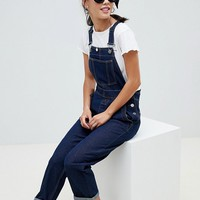 ASOS DESIGN Petite denim dungaree in rinsewash at asos.com