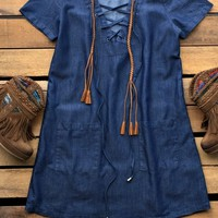 Our Always Wanting You Dress would be perfect paired with some boots! It's a short sleeve denim dress with a lace up neckline and front pockets. Made to be loose fitted. Unlined.