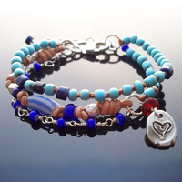 Blue bead bracelet African trade beads jewelry Multi layer bracelet with an Artist silver charm