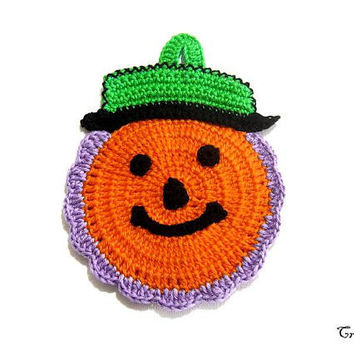 Orange Purple and Green Halloween crochet pumpkin potholder, presina zucca arancione lilla e verde per Halloween all'uncinetto
