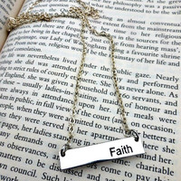 "Silver metal bar with with word ""faith"" engraved in it and sterling silver chain necklace."