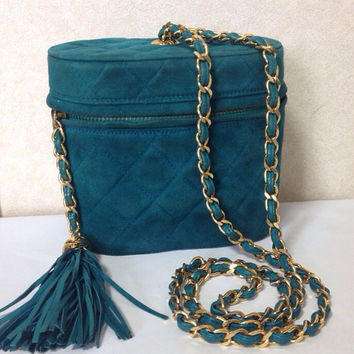 Vintage CHANEL emerald green color suede leather chain shoulder vanity purse with gold tone chain straps and CC tassel.