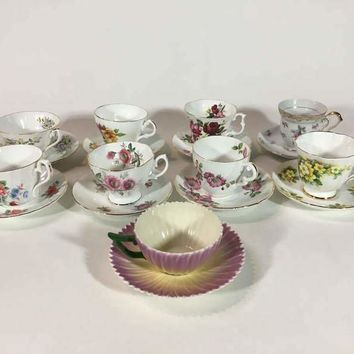 Group of Nine English Painted Porcelain Teacup and Saucer Sets