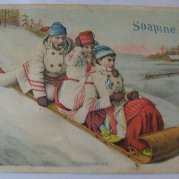 Soapine Trade Card antique card vintage washing cleaning soap ad Tobogganing Motif Father Son Daughter playing in snow old ad for soap