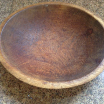 Antique hand turned semi-burled  wooden bowl. Oblong in shape with a beautiful primitive patina.
