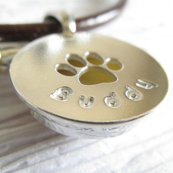 Pet memorial paw print pendant necklace. Sterling silver, glass & leather. Cremation necklace ashes of your dog or cat. Personalized name.