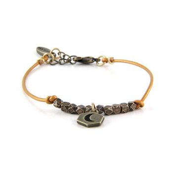 Charming the Wild West with Brass Moon Charm and Indian Sun Leather Bracelet