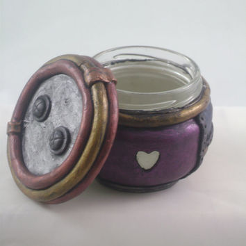 Recycled jar with sculpted polymer clay painted in jewel tone metallic acylics
