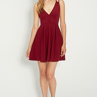 strappy little red dress with textured fabric