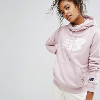 New Balance Pullover Logo Hoodie In Pink at asos.com