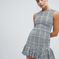 Missguided peplum hem mini dress in check at asos.com