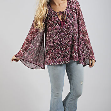 show me your mumu: bardot tassel top - jewel of the nile