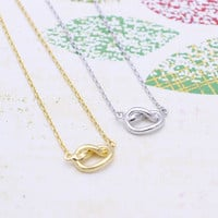 Tiny knot necklace in  silver or gold tone