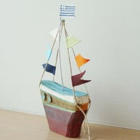 Ceramic sailing boat with colourful flags, stoneware clay boat sculpture with wire mast and fabric flags, Greek pottery boat