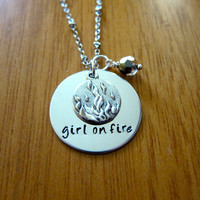 """Hunger Games Inspired Necklace. Katniss """"girl on fire"""". Hand stamped, silver colored, charm pendant, Swarovski crystal, jewelry."""