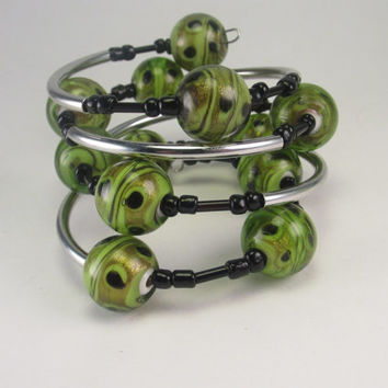 Green and Black Seed Bead Memory Wire Bracelet with Silver Tube Beads