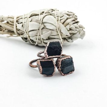Raw Black Tourmaline Ring in a Gold setting, with additional gold stackers