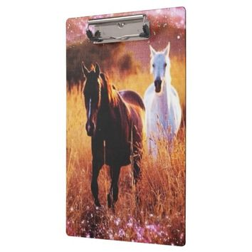 Wild horses running free in field western country Clipboard