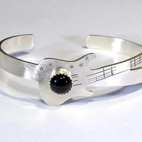 Sterling silver guitar bracelet with musical inspiration and black onyx gemstone