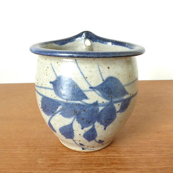Handmade pottery wall pocket vase with blue leaf detail marked Huddleston 1994